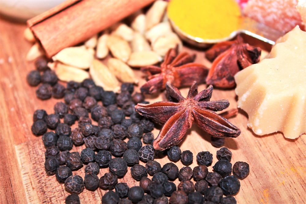 Anise star, black peppercorns, cinnamon stick, turmeric, and maple