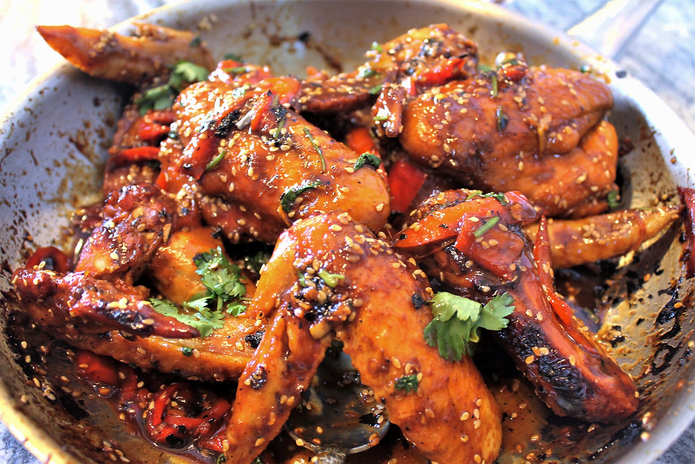 Homemade chicken wings in a pan with homemade teriyaki sauce