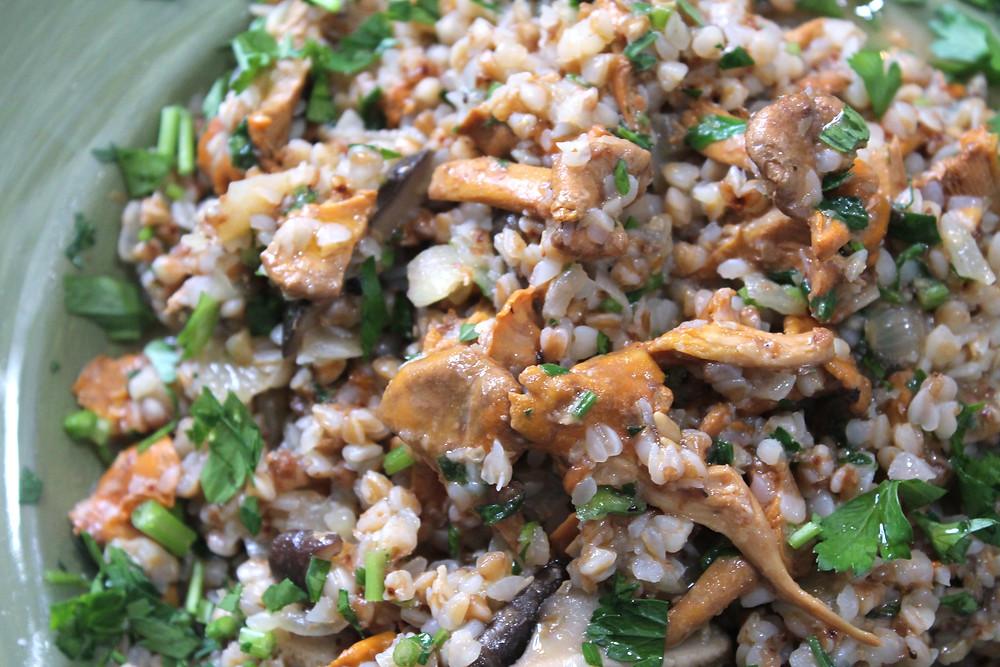 Close up of buckwheat risotto with chanterelles and shitake mushrooms