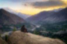 Woman looking down a mountainous valley.