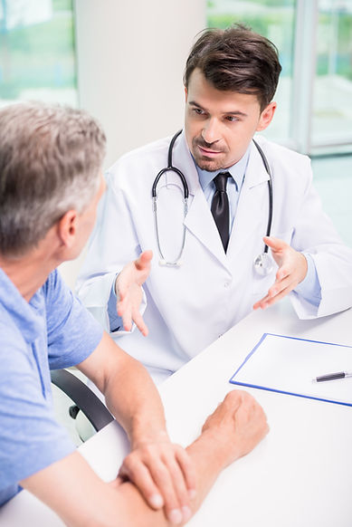 Male doctor talking with patient serious