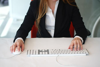 Professional female typing at a computer