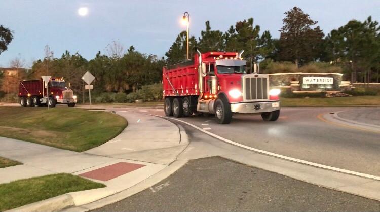 Dump trucks circle the roundabout on Marsh Road in Winter Garden