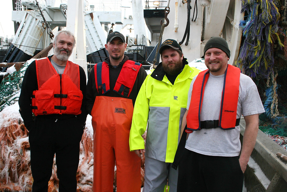 Commercial fishermen modeling a variety of personal flotation devices (PFDs).
