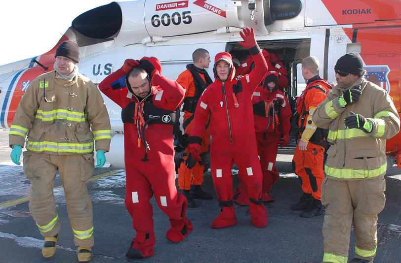 Rescued Commercial Fishermen Exit USCG Helicopter