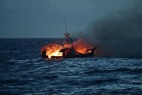 The 46-foot fishing vessel, Miss Emma, burning nearKo'Olina, Oahu, Hawaii. The Coast guard rescued all seven crew.