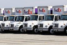 fleet-fedex-delivery-trucks-parking-lot-