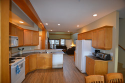 411 Kitch to LR with Loft Stairs