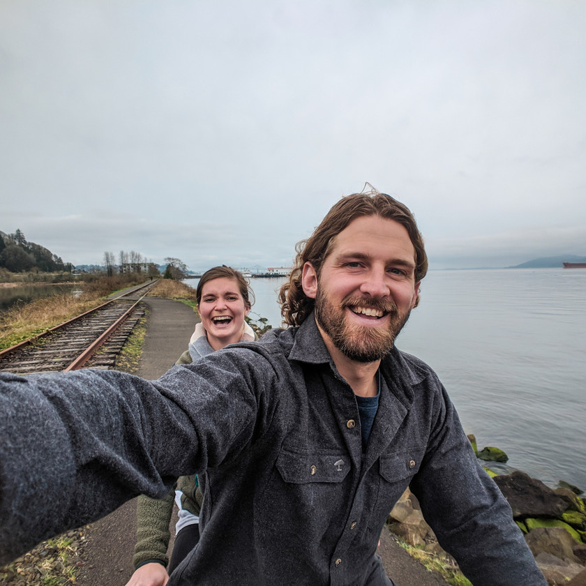 Steph and Scott from Each Day Slow riding a tandem bike in Astoria, Oregon and celebrate one year of marriage.