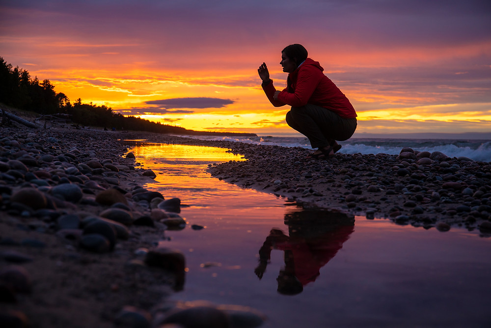 Steph from the Each Day Slow blog looking for rocks and enjoying the sunset in Northern Michigan.