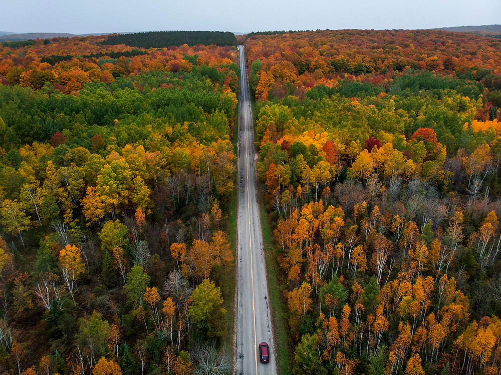 A drone view of Robinson Road north of Harbor Springs in Northern Michigan with fall color.