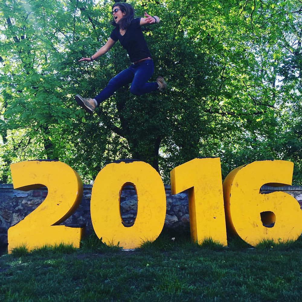 Steph jumping off the number 2016 while traveling in Krakow, Poland.