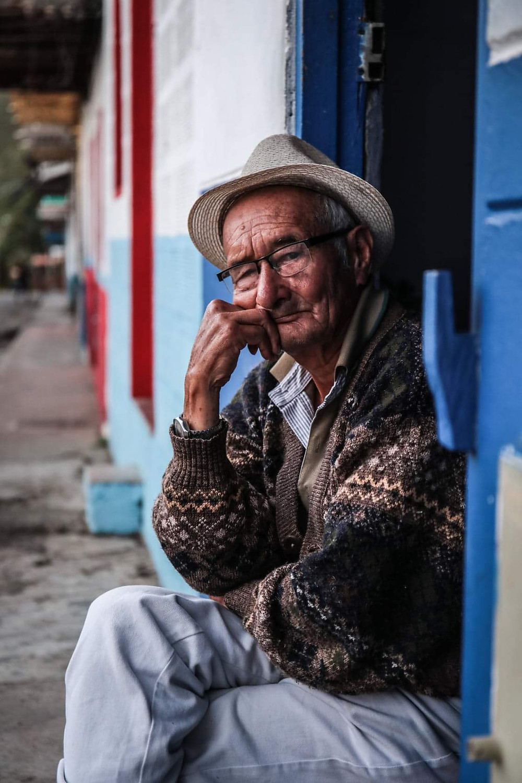 Man sitting in doorway in Jardin, Colombia.
