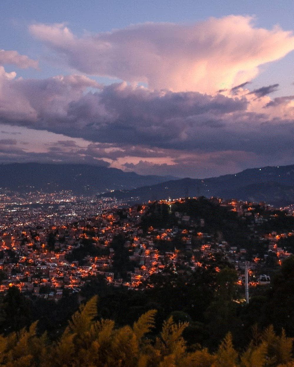 Evening overview from the top of the North gondola route in Medellín, Colombia.