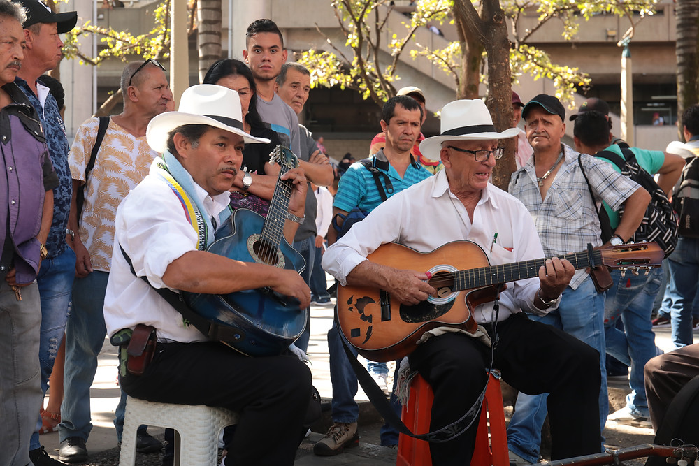 Men performing traditional Colombian songs in the square in Medellín, Colombia.