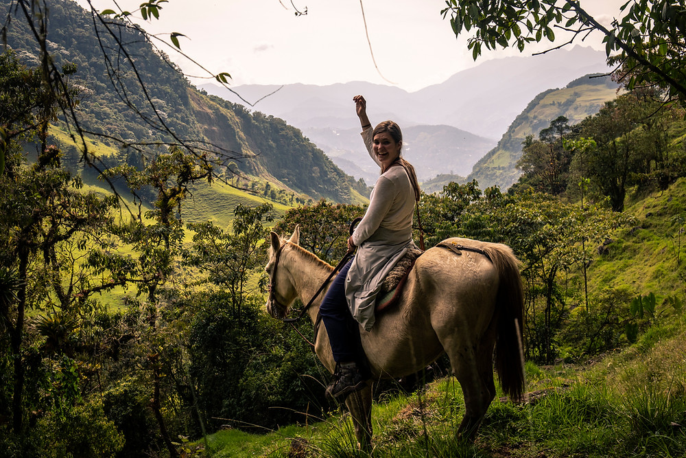 Emerging from the jungle while horseback riding in Jardin, Colombia.