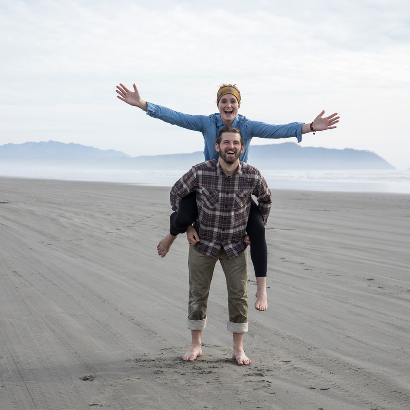 Steph and Scott from Each Day Slow on Sunset Beach near Astoria, Oregon.