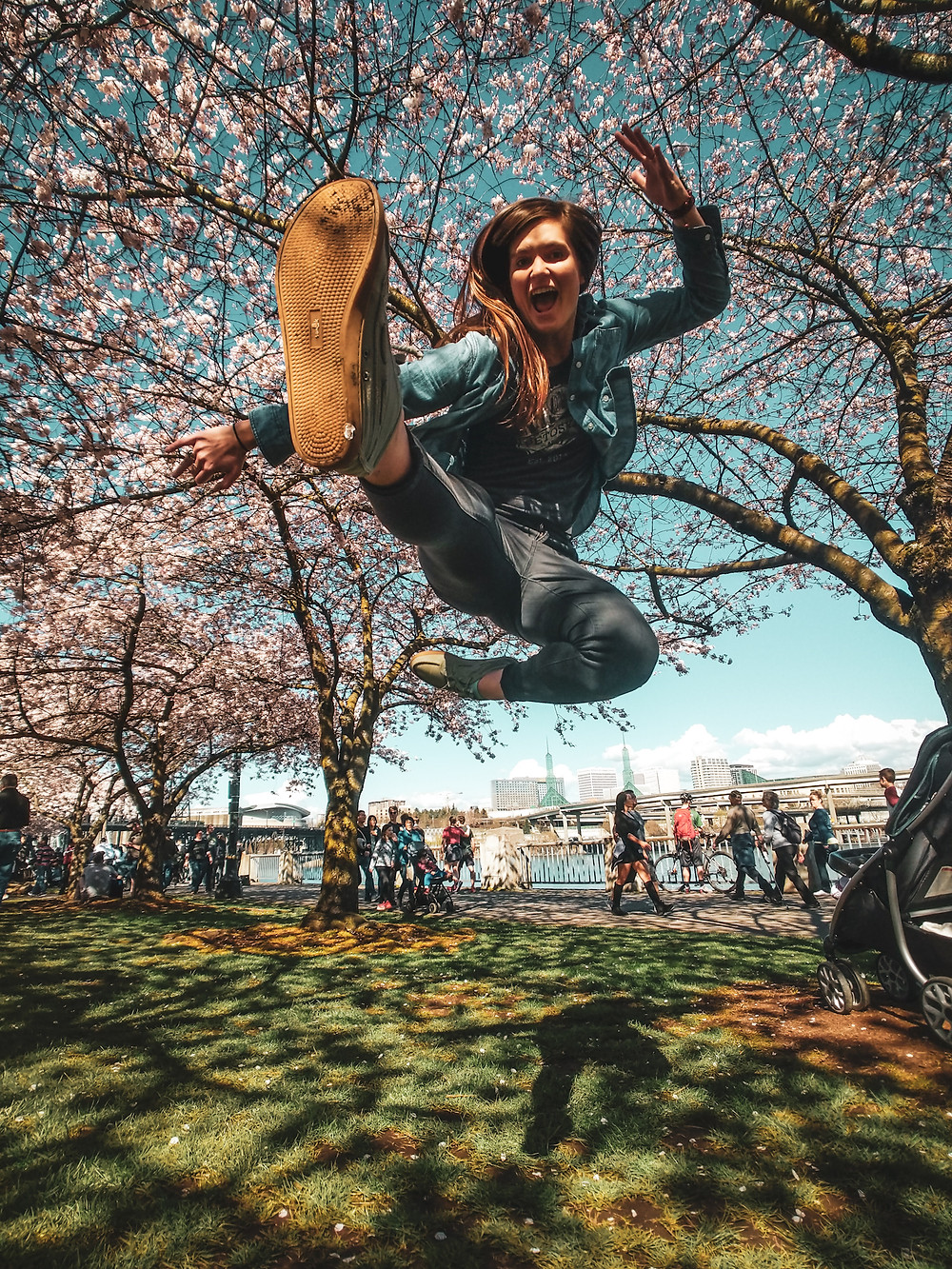 Jumping in front of the cherry trees at the Japanese American Historical Plaza in Portland in the PNW.