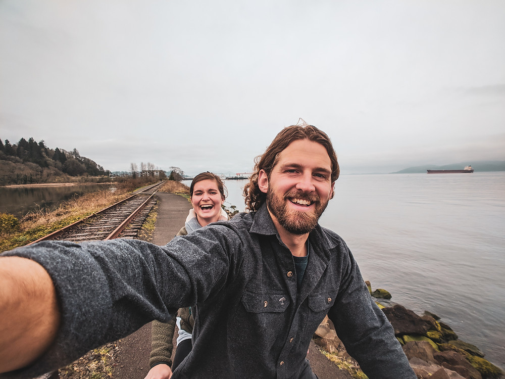 Riding a tandem bike on the Riverwalk in Astoria, Oregon during our PNW road trip.