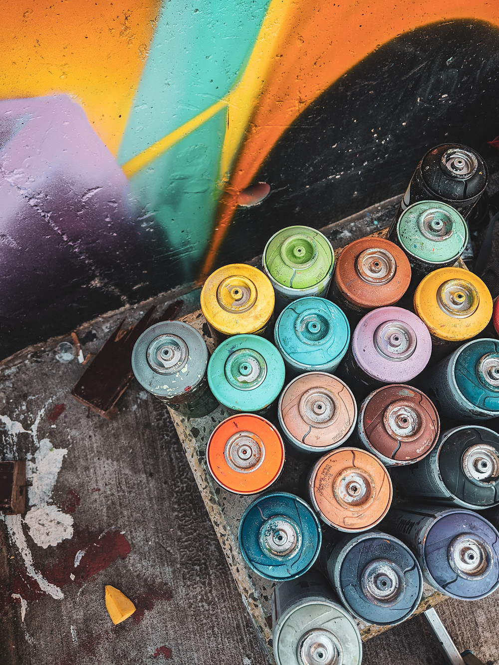Spray paint cans next to a graffiti mural in Comuna 13 in Medellín, Colombia.