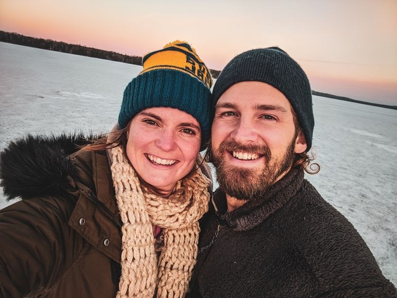 Steph and Scott from Each Day Slow ice fishing in Northern Michigan.