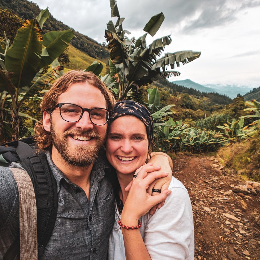 Steph and Scott from Each Day Slow hiking in the mountains in Jardin, Colombia.