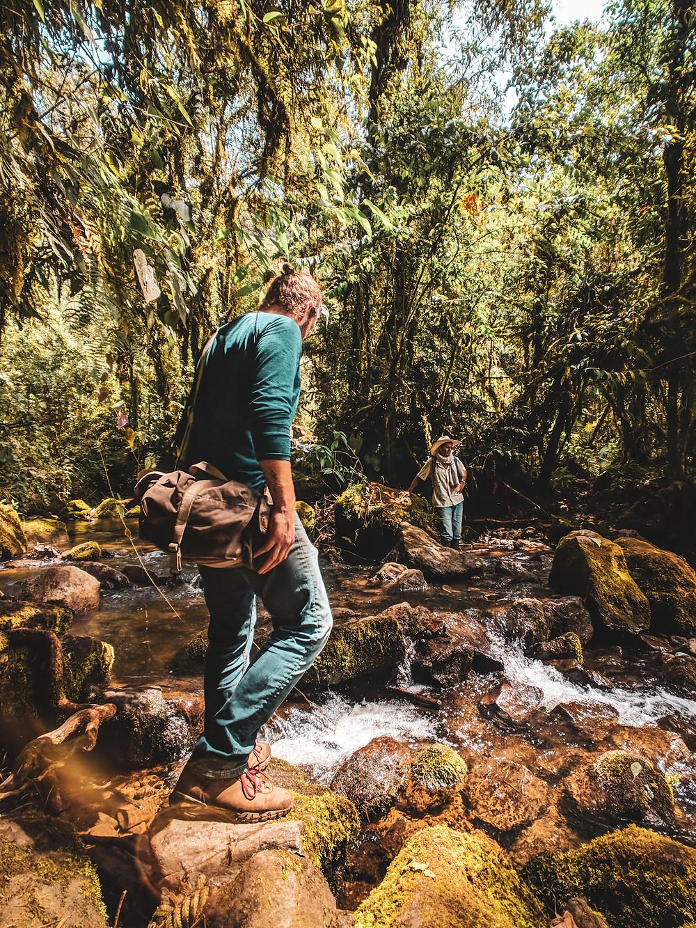 Hiking across rivers in Jardin, Colombia.