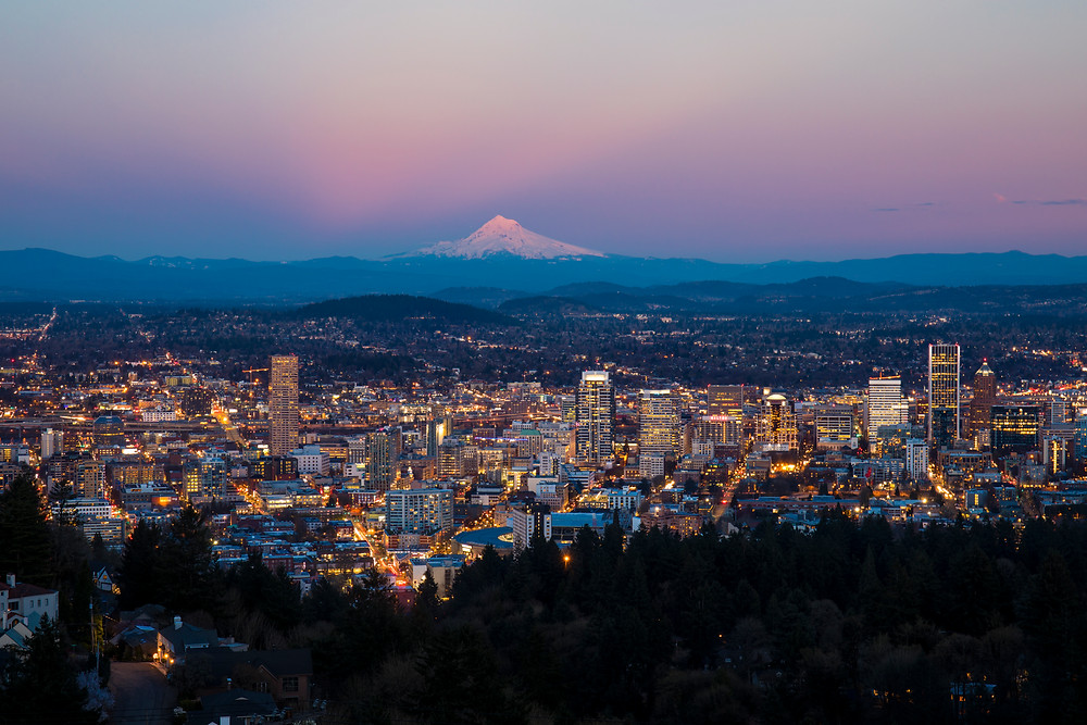 Portland cityscape at dusk with Mt. Hood in the background from the Pittock Mansion overlook in the PNW.