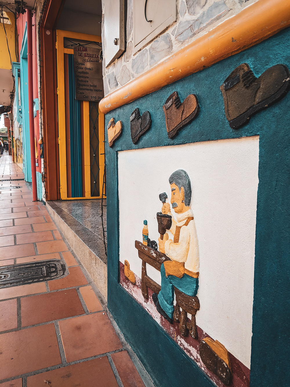 A zocolas outside of a building in the colorful Guatapé, Colombia.