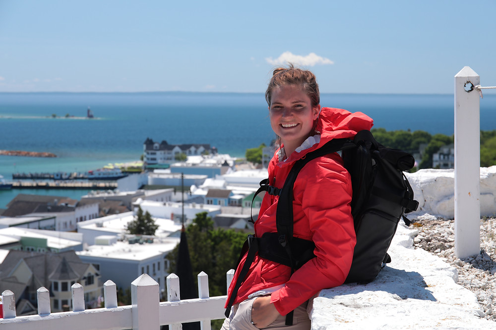 Steph from the Each Day Slow blog on top of Fort Mackinac while traveling.