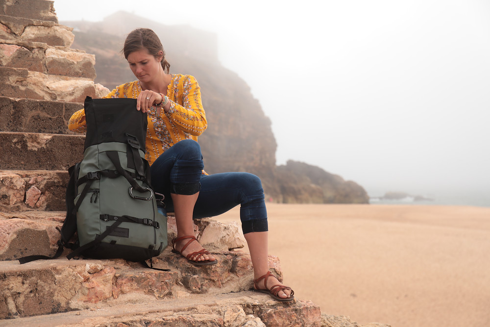 Steph from the Each Day Slow blog using a WANDRD backpack while traveling in Portugal.