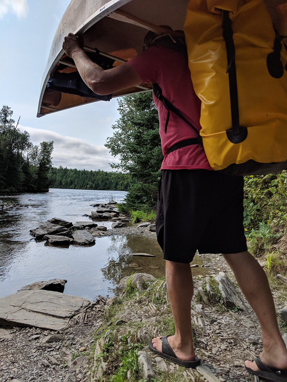 Scott portaging with our new backpack and canoe while we prepared our packing list for the Boundary Waters