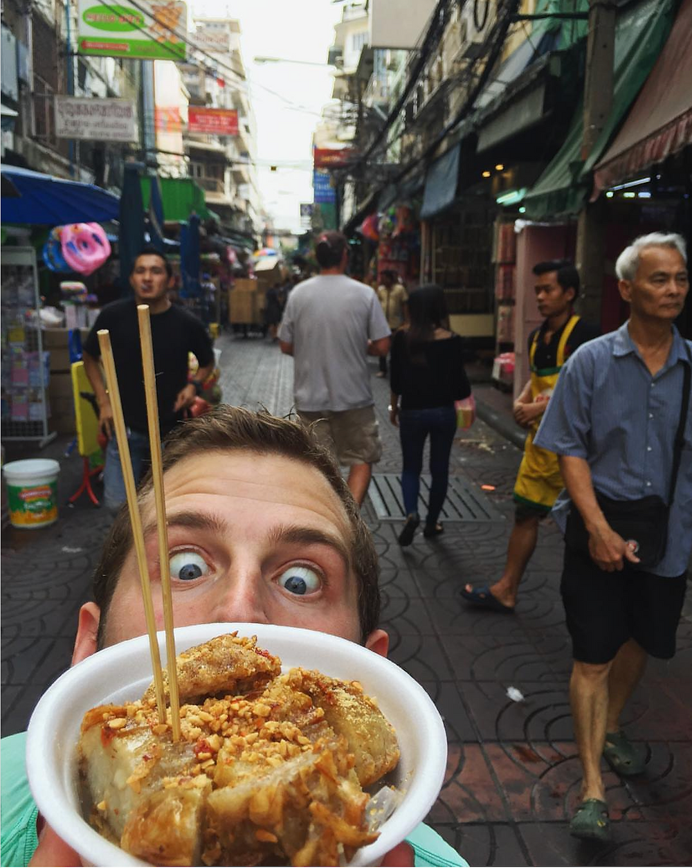 Getting street food while traveling in Bangkok, Thailand.