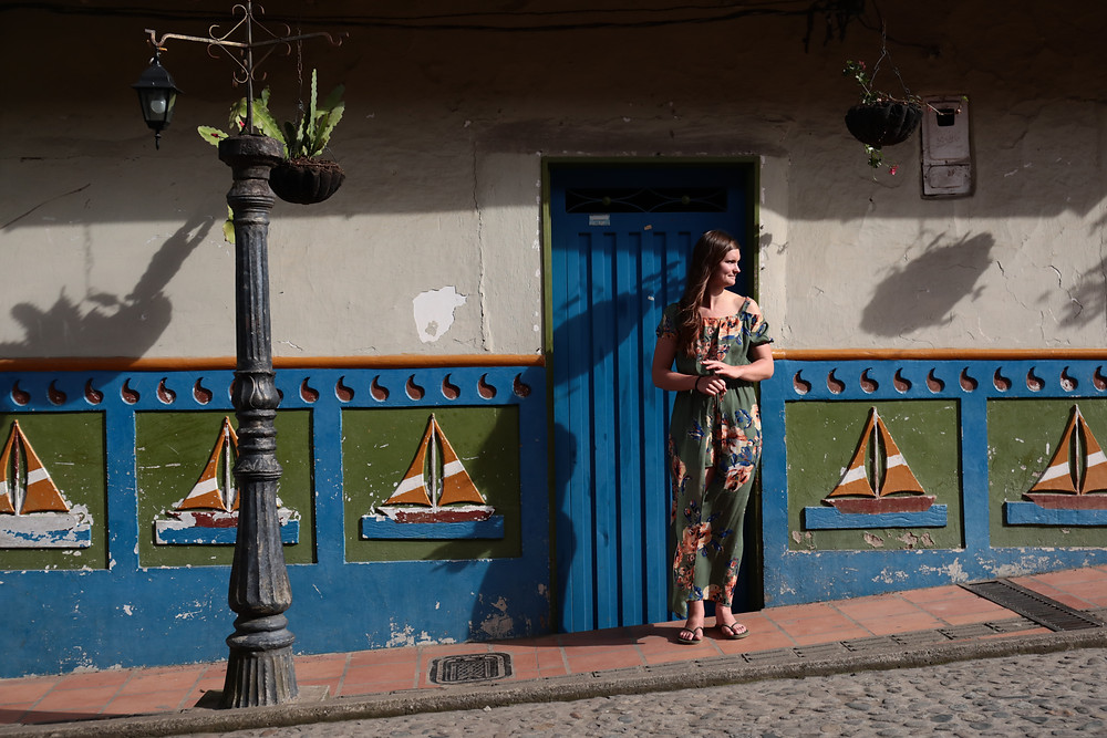 In front of the zocolas in Guatape, Colombia.