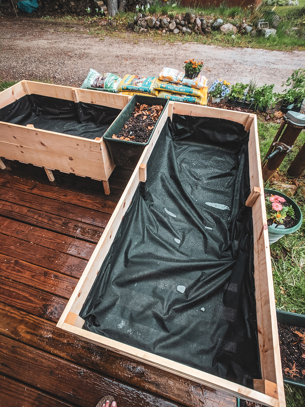 The finished DIY raised garden beds perfect for a small space in Northern Michigan. They were designed by Steph Castelein from the Each Day Slow blog.