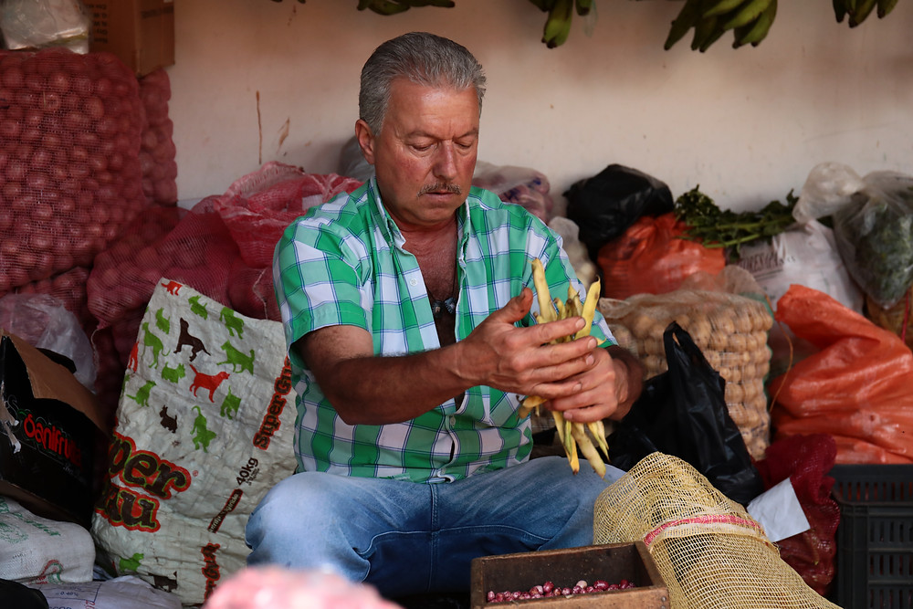 A man shelling beans in Guatapé, Colombia.