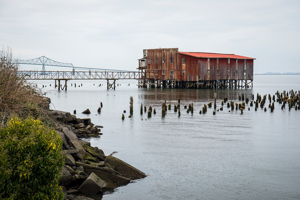 An old building along the Riverwalk in Astoria, Oregon during our PNW road trip.