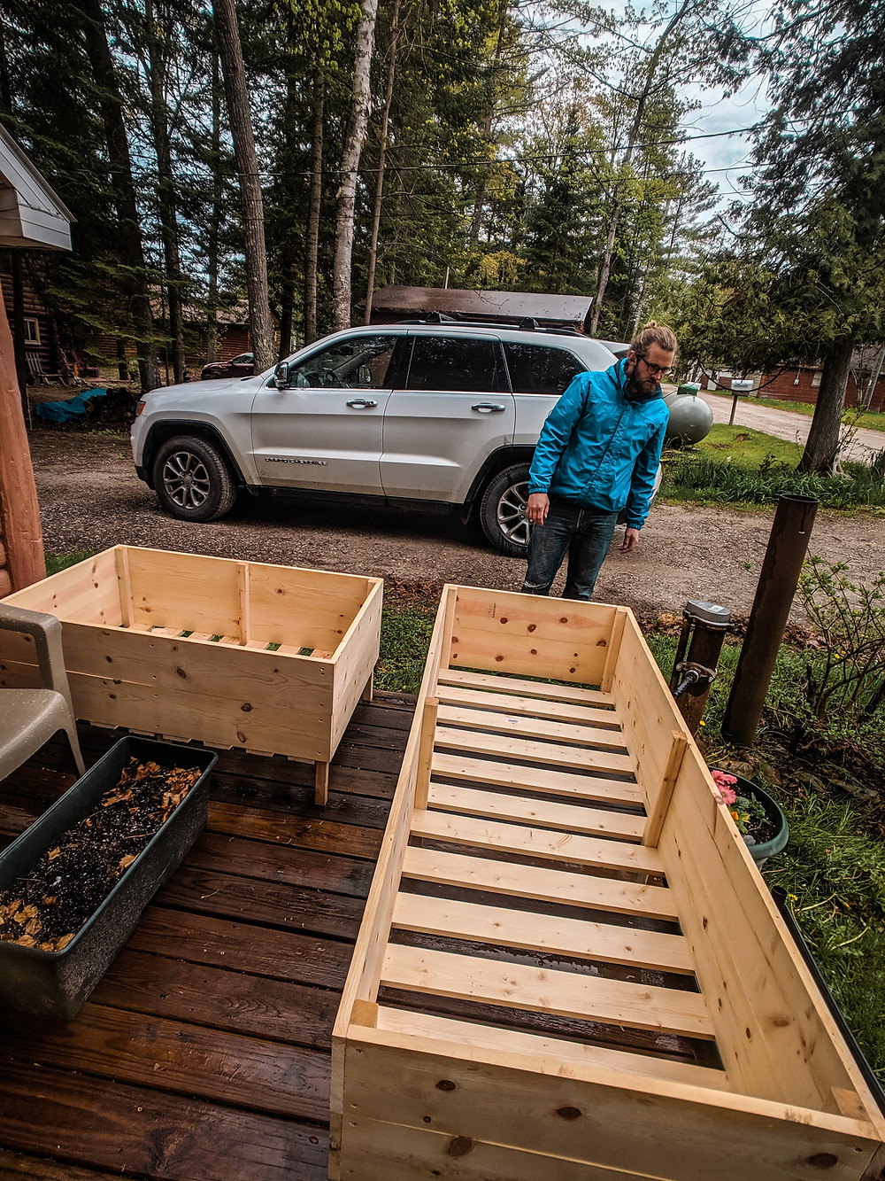 Deciding where to put our DIY raised garden beds made by Steph Castelein at Each Day Slow in Northern Michigan.