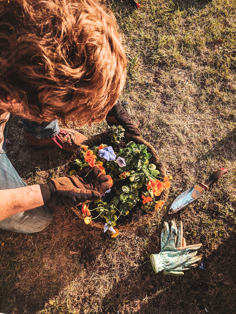 Scott planting flowers. We've been trying to find ways to slow down more and more lately.