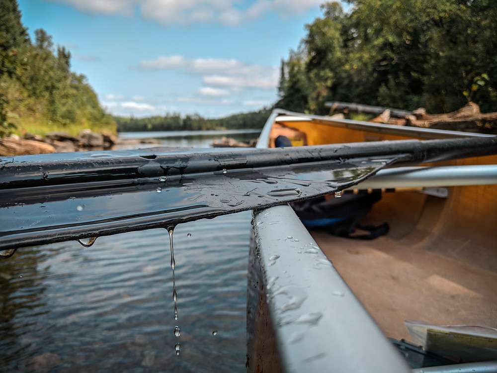 Water dripping from my paddle as we made our way traveling through the Boundary Waters.