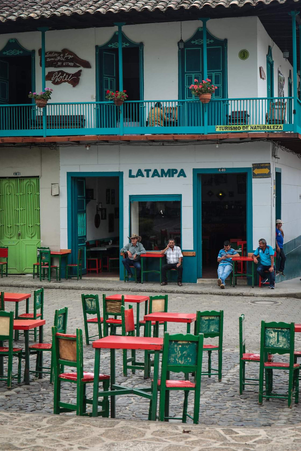People sitting in the main square in Jardin, Colombia.