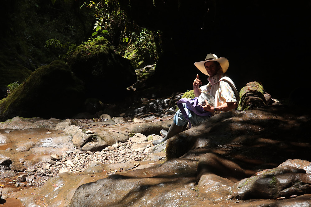 Eating lunch next to the waterfall in the mountains of Jardin, Colombia.