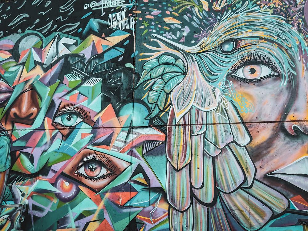 Colorful graffiti mural in Comuna 13 in Medellín, Colombia.