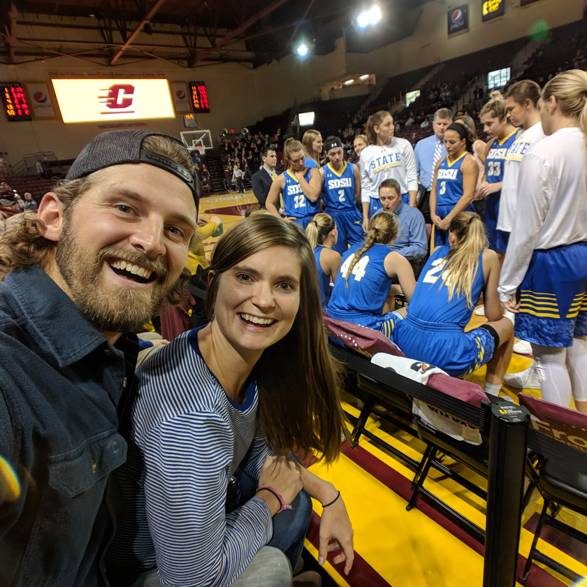 Steph and Scott from Each Day Slow cheering on the SDSU Jackrabbits and the women's basketball team at CMU.