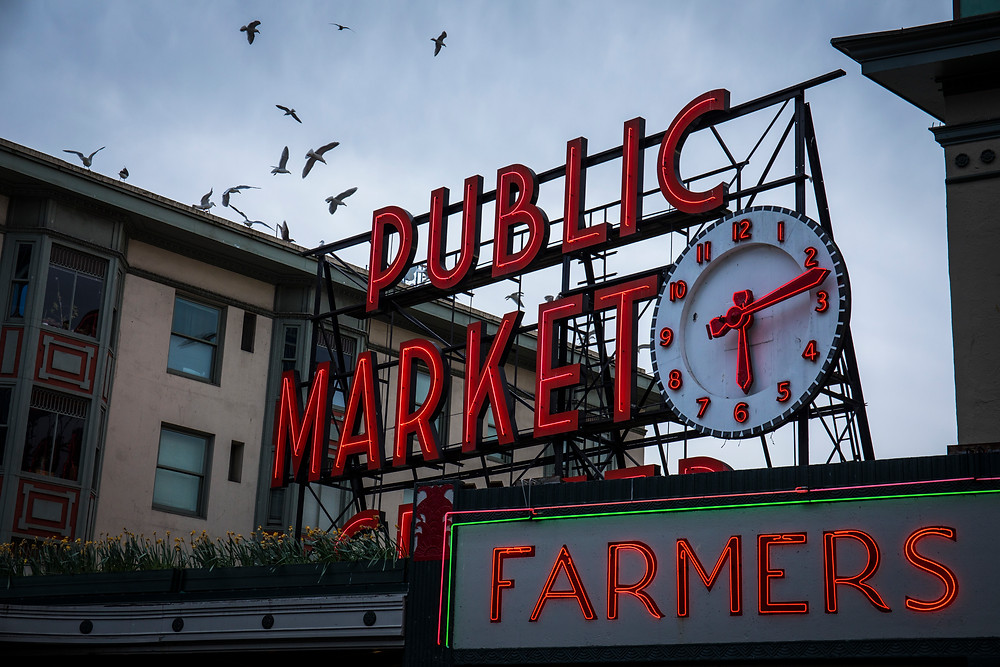 Iconic signs at Pike Place Market in Seattle, Washington during our road trip to the PNW.