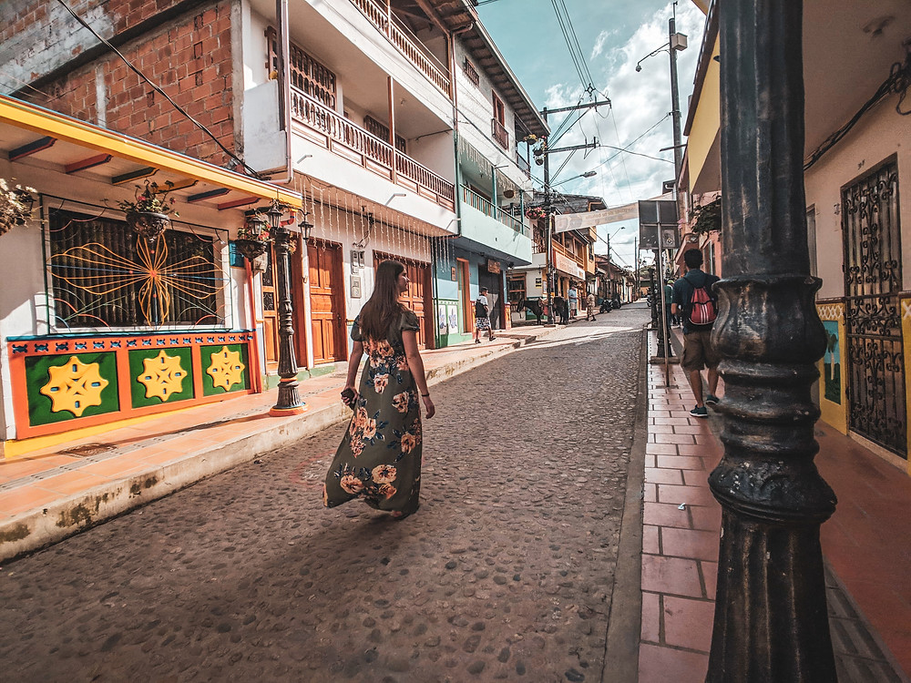 Walking down the colorful streets of Guatapé, Colombia.