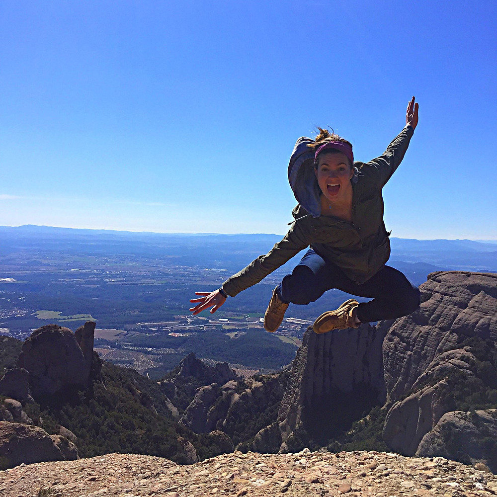Steph jumping on top of the Mountains of Montserrat near Barcelona.
