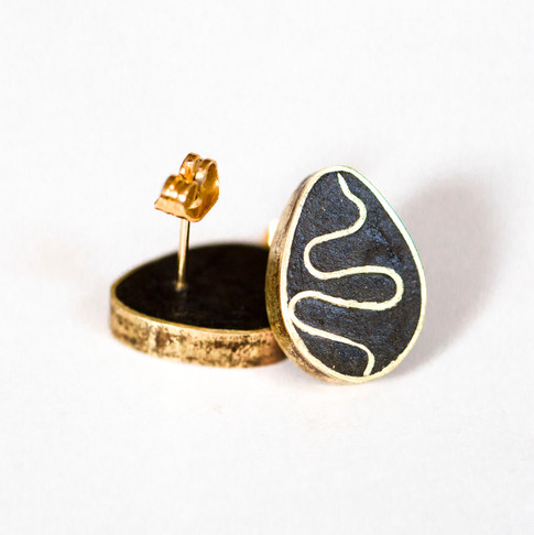 Paper and brass 'egg' studs