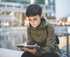 Young Woman Reading Tablet