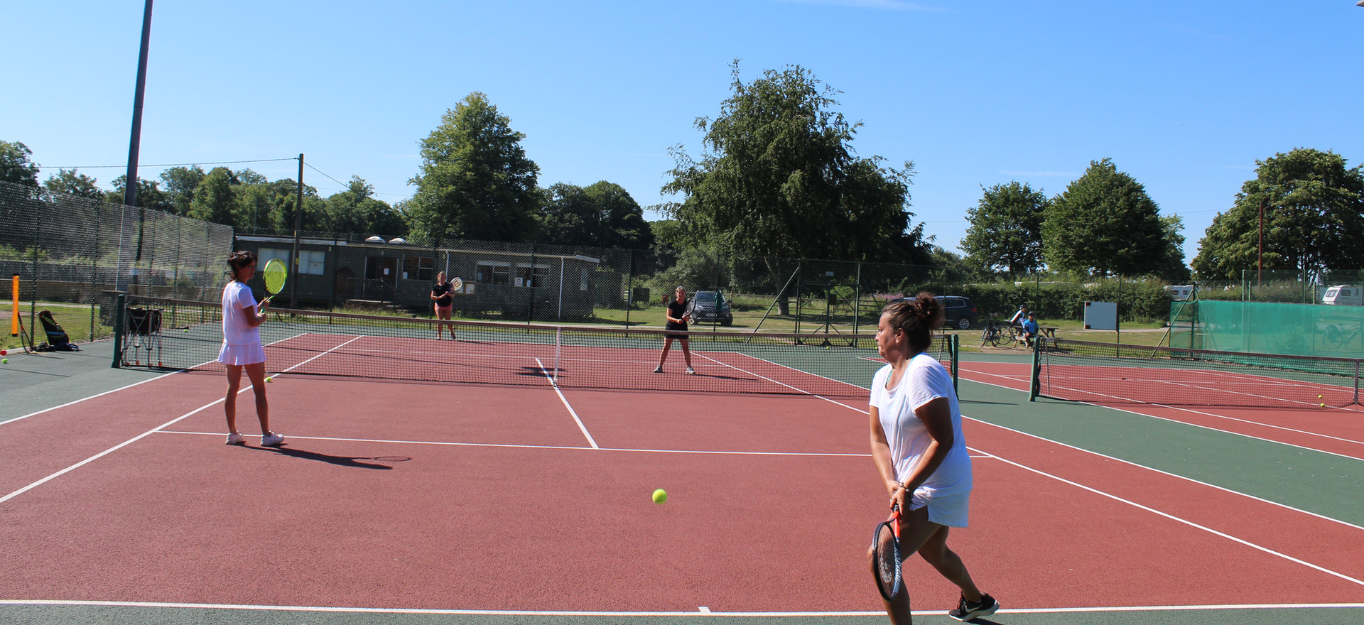 Ladies doubles on a warm Tuesday evening in August